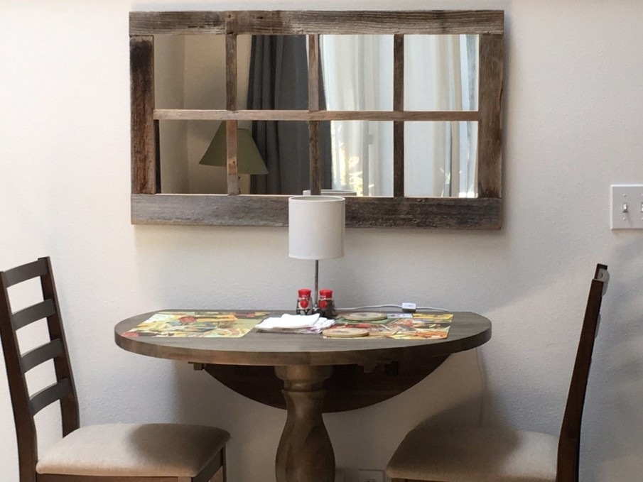 Love this windowpane rustic wall mirror over a small breakfast table