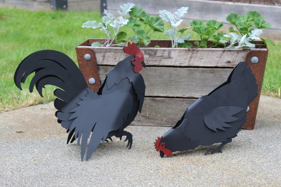 Iron rooster and hen yard art