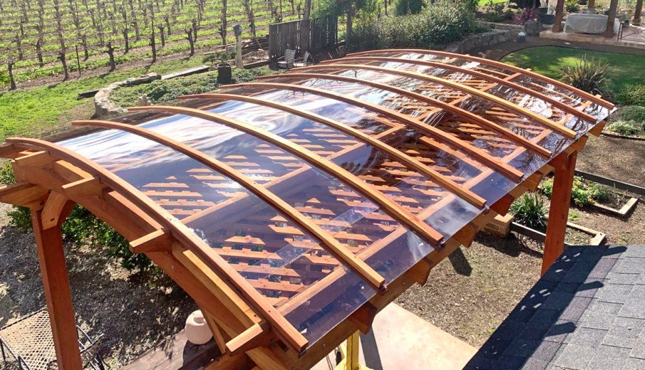 Traditional wood pergola with clear acrylic roof
