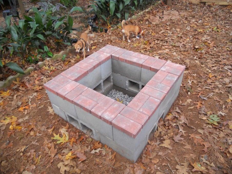 Cinder block firepit covered with red bricks