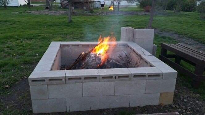 An over sized concrete block fire pit
