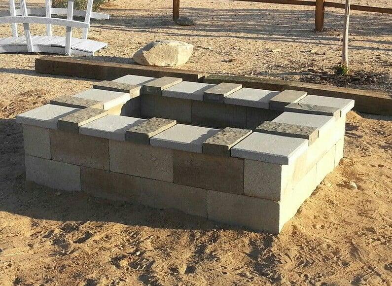 A decorative outdoor cinder block fire pit idea