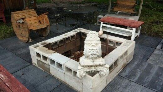 Concrete block fire pit on a patio