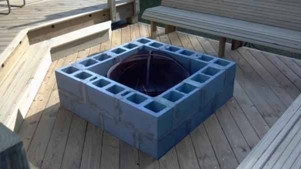 Concrete block fire pit on a wooden deck