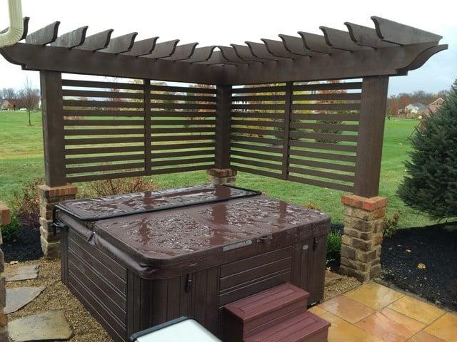 Corner hot tub pergola with privacy enclosure idea
