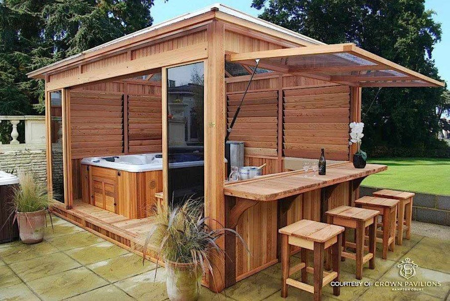 Luxury pergola size for hot tub includes a bar and glass doors