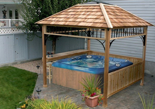 Hot tub pergola kit with ironwork accents and cedar roof