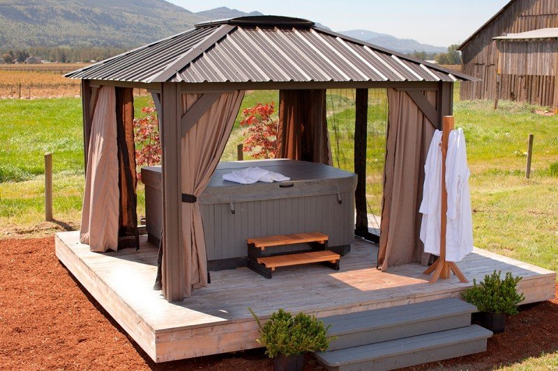 Metal roof hot tub pergola with privacy curtains and insect screens