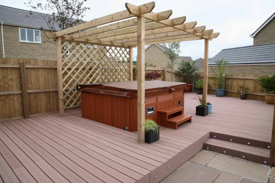 Solid wood pergola with privacy enclosure over above ground hot tub