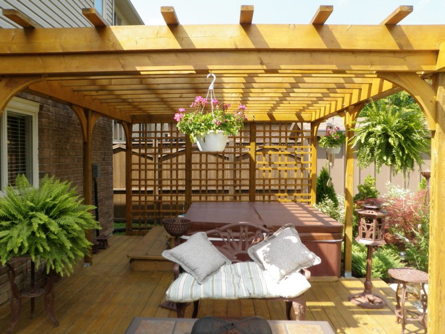 Hot tub privacy screen and pergola made of weather-resistant wood
