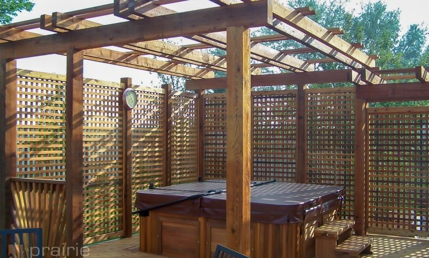 Made from weather-resistant cedar outdoor hot tub pergola has lattice sides