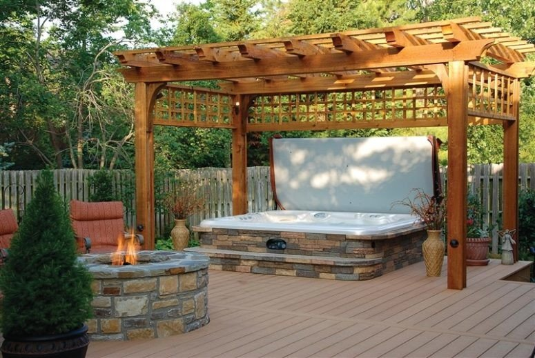 Traditional wooden pergola installed above a hot tub on a deck