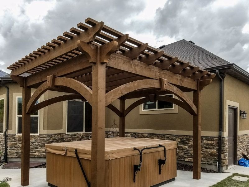 The Early American Style Pergola installed over hot tub