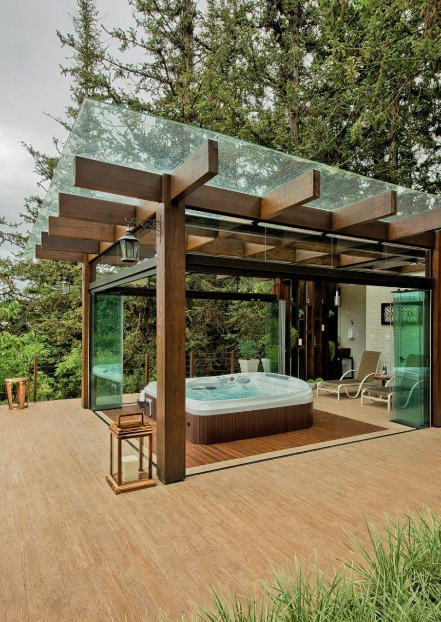 Wood oversized tub pergola with glass folding doors and roof