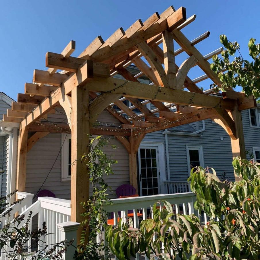Unusual pitched roof pergola desig idea