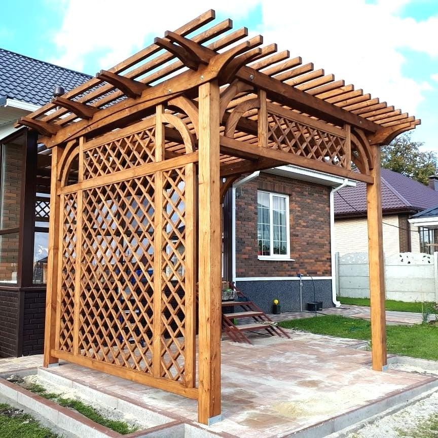 Small wood pergola with unusual lattice design
