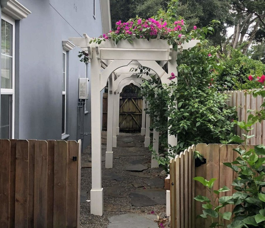 An interesting idea for creating a garden arbor from small wood pergolas