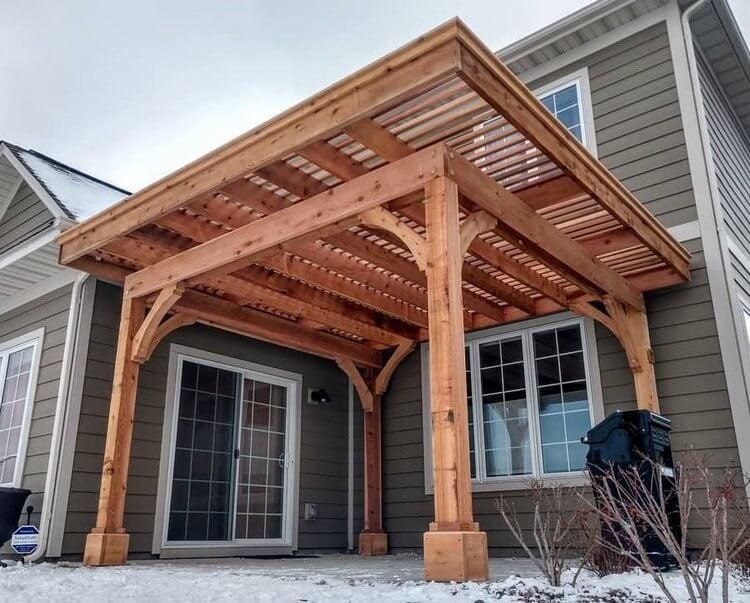 A square pergola design idea with an unusual roof