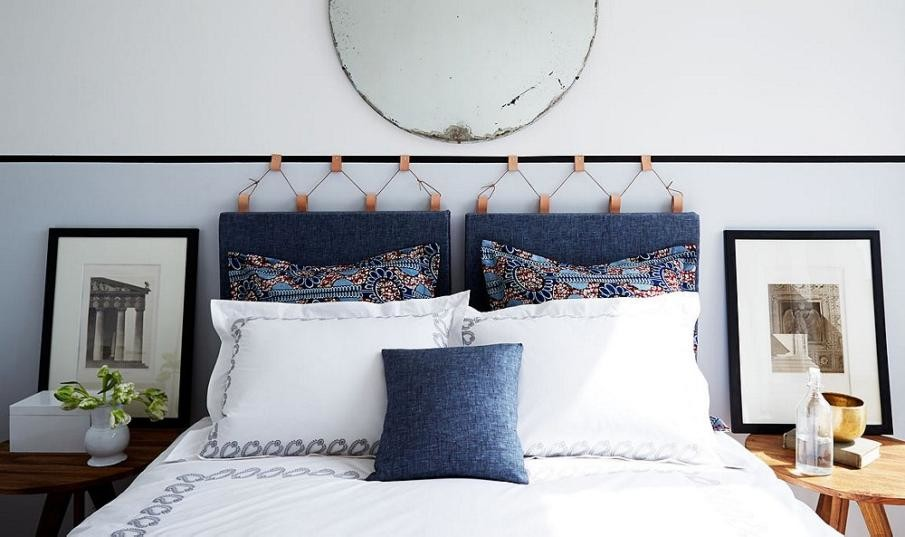 Easy upholstered headboard idea with hanging cushions