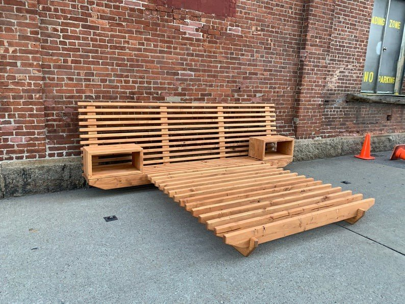 A wooden bed with headboard and storage