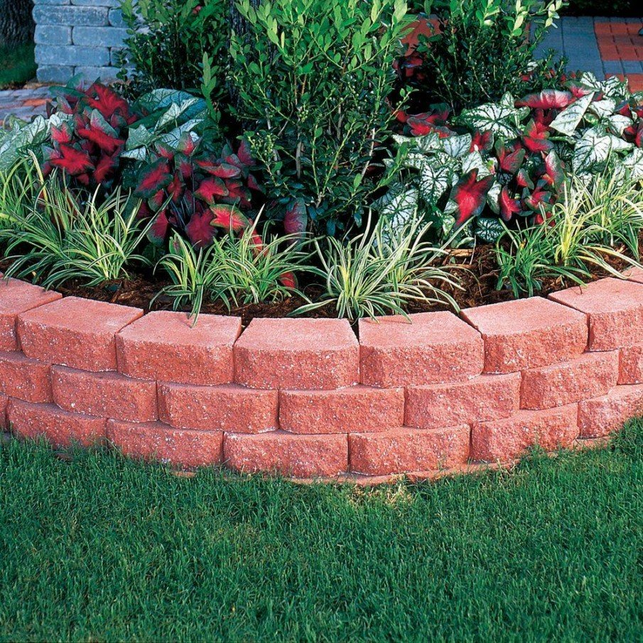 Low retaining wall of pavers for a raised flower bed