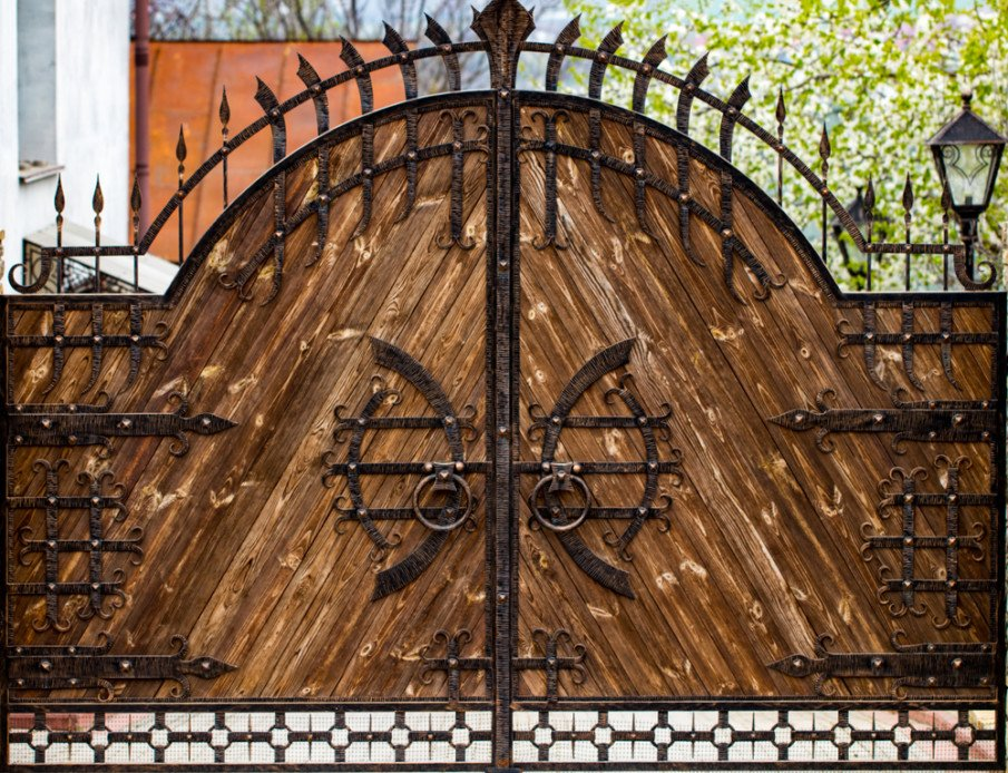 Unique wrought iron gate with wood slats