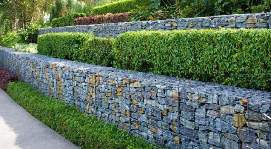 Tiered gabion walls separate distinct landscaped areas