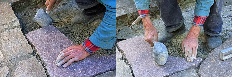 Using a rubber mallet to secure flagstones