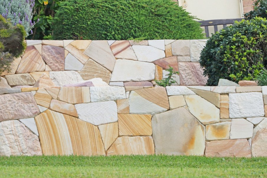 Dry stacked sandstone large retaining wall