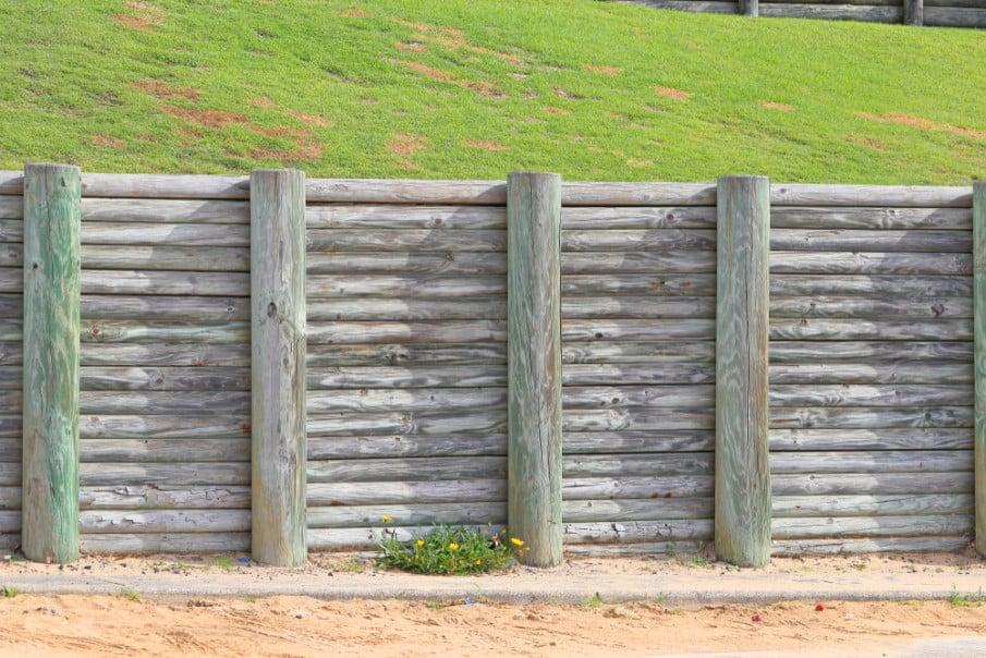 Tall pine log retaining wall