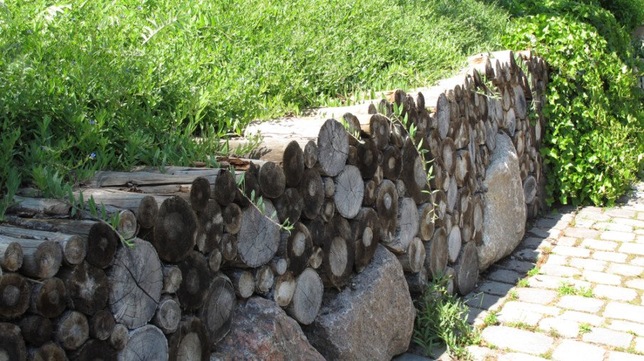 Creative combination of wood logs and stone boulders