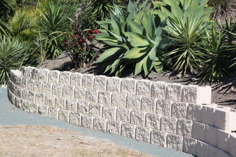 A cinder block retaining wall in an Australian garden