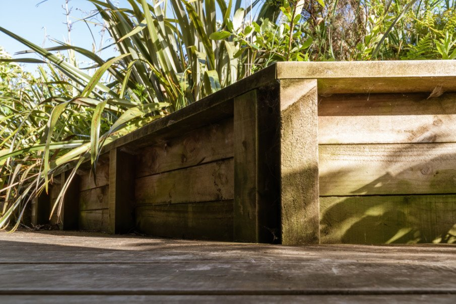 Retaining wall constructed of treated pine - simple corner design