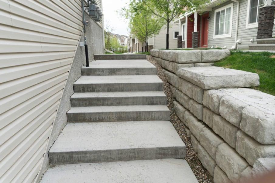 Small retaining wall construsted of custom cement blocks