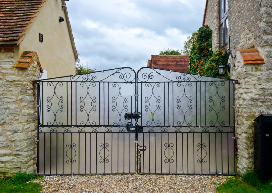 A gate with ironwork and privacy screen