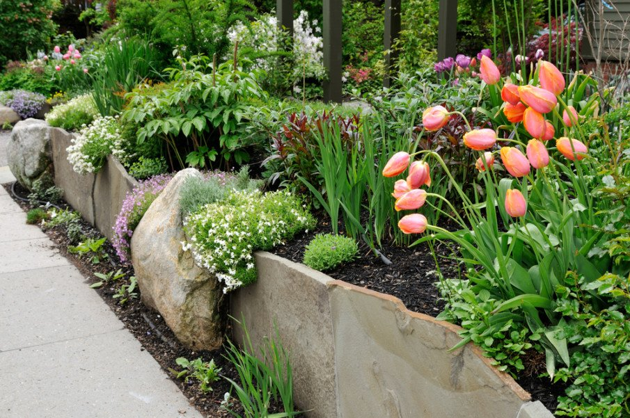 Wall combines large boulders with flagstones