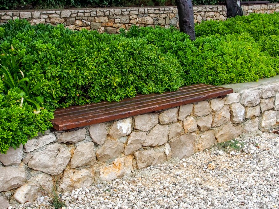 Natual stone wall with wood bench