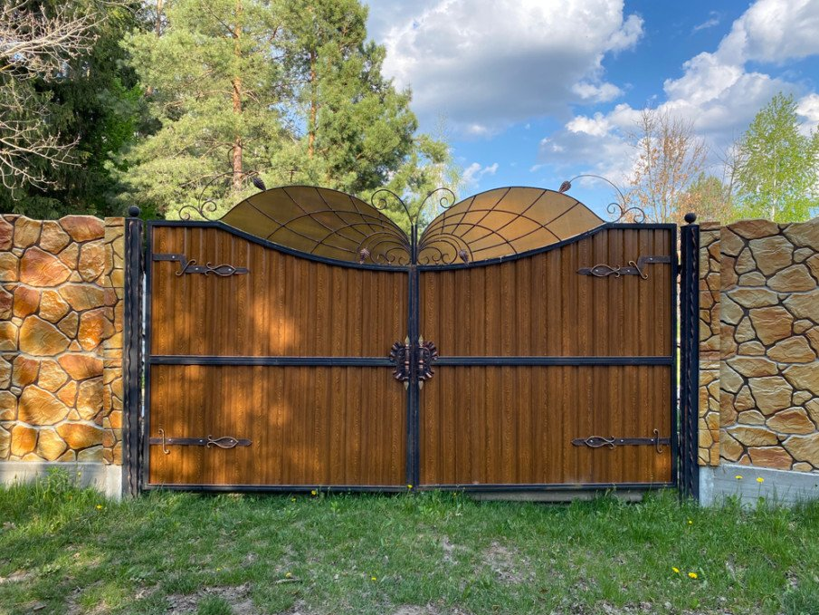 Wrought iron gates with wood designs