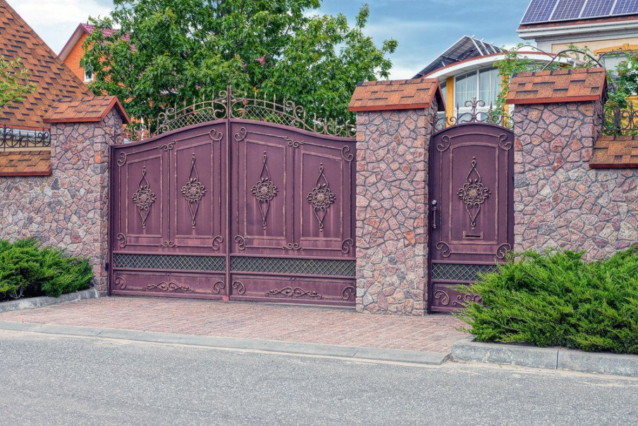 Unusual driveway wrought iron gate