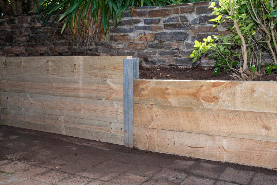 Small wood retaining wall for driveway area
