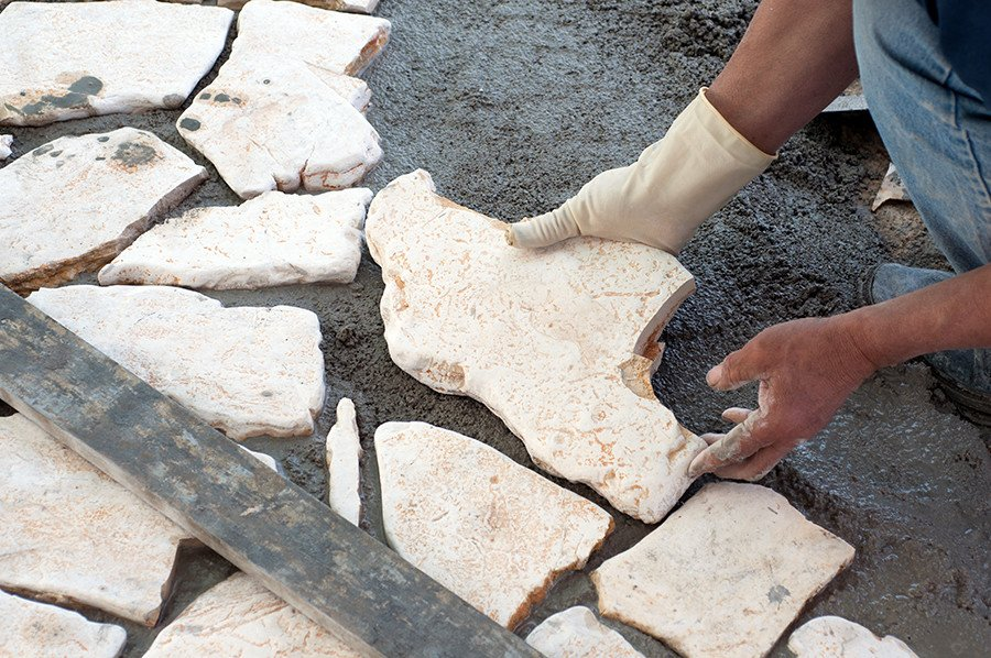 Setting flagstones on a cement base