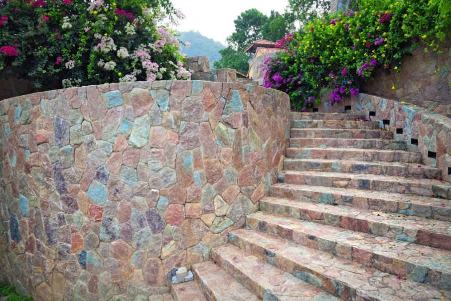 Mutli-colored stone decorative retaining wall with staircase
