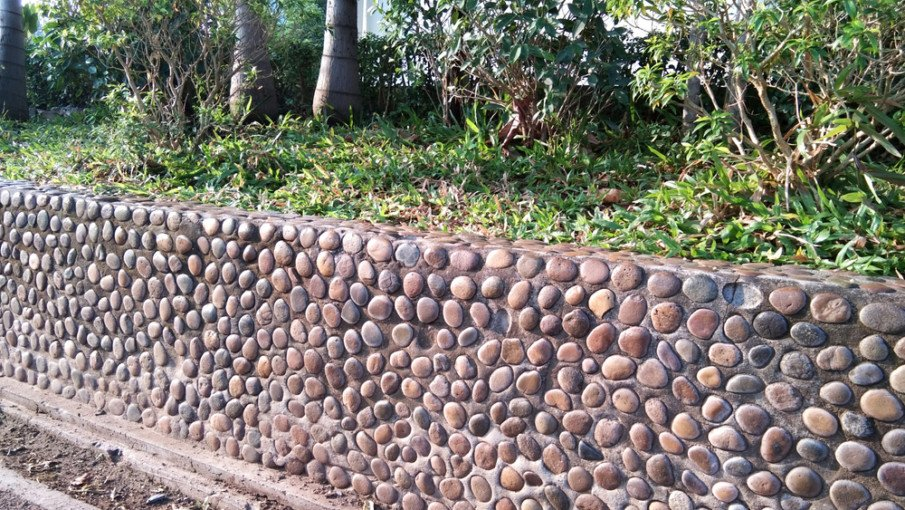 Small stones used to build rustic wall in garden