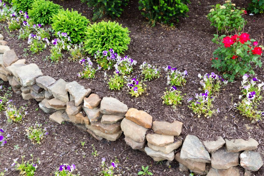 Gently curved natural rock retaining wall