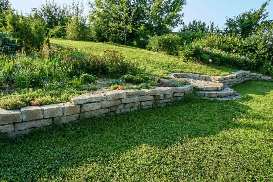 Made of limestone, sloped retaining wall has circular steps
