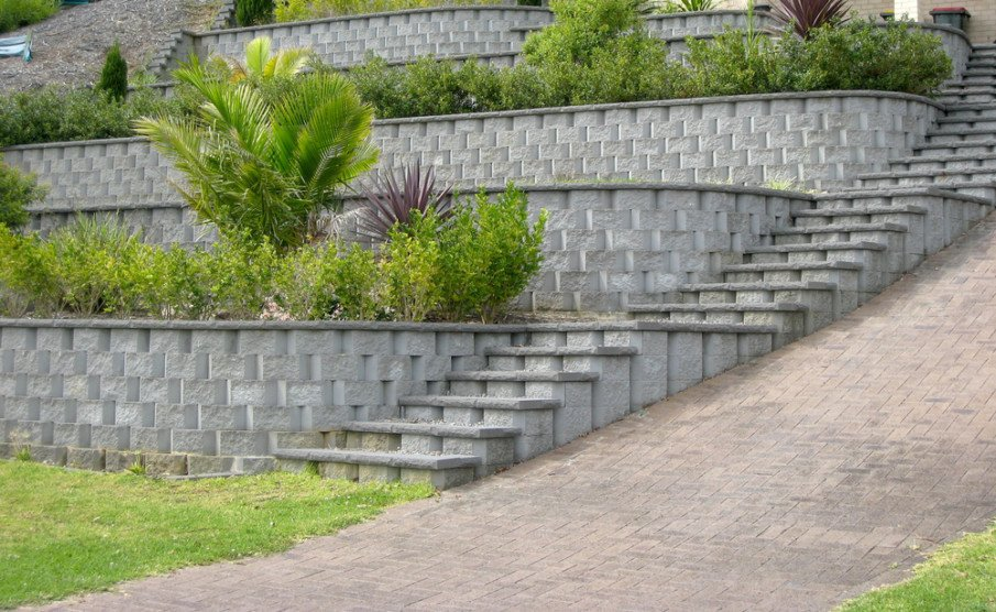 Series of terraced retaining walls constructed of concrete blocks