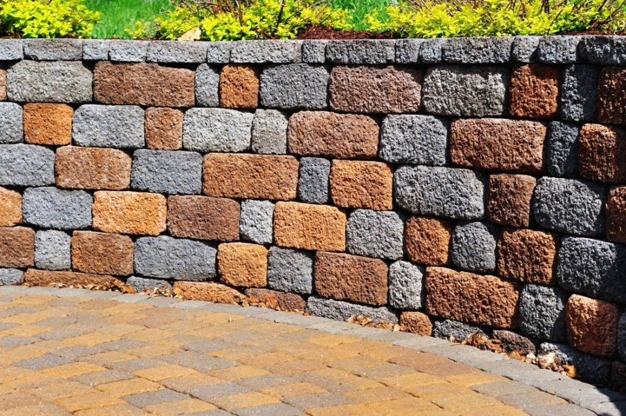 Patio retaining wall made from pavers with landscaping