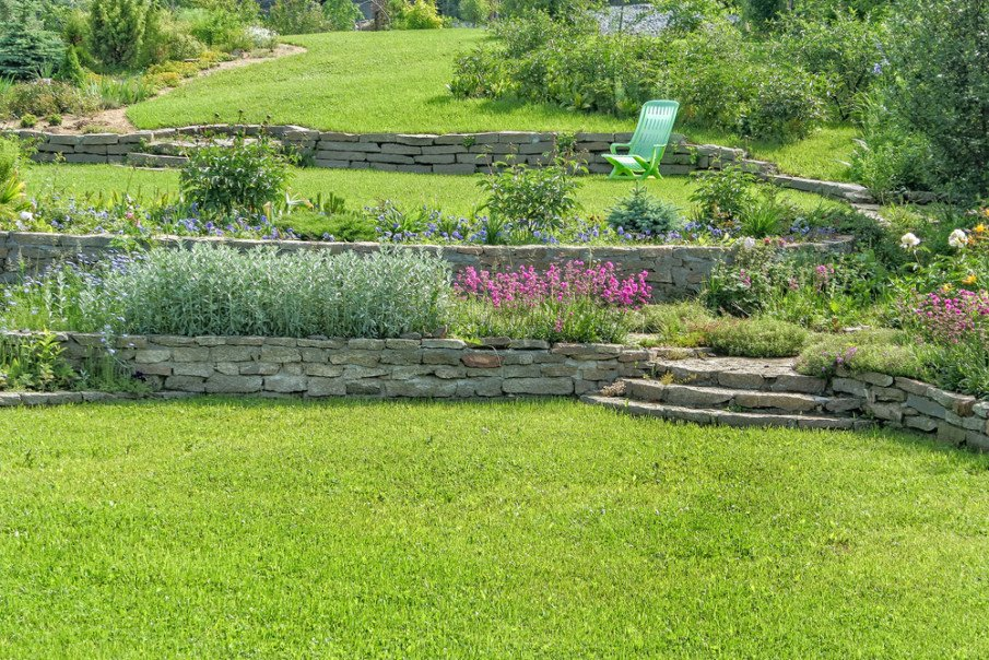 Garden with terraced natural stone retaining wall and steps