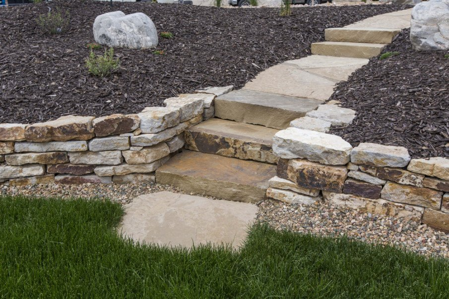 Ideas for hardscaping - natural stone steps built into natural rock wall