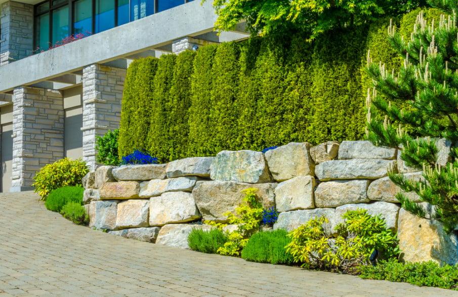 Limestone wall is part of modern landscape design